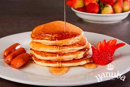 Pancakes + fruta + jugo + bebida caliente