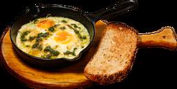 Huevos en Pesto