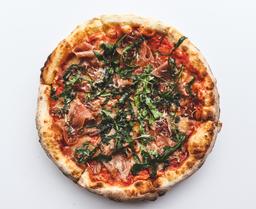 Pizza de prosciutto y Datiles
