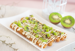 Churros con chocolate blanco y kiwi