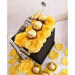 Rosas amarillas chocolates y cervezas