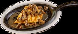 Pechuga a la parrilla en salsa de champiñones
