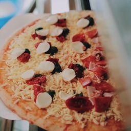 Pizza mitad/mitad