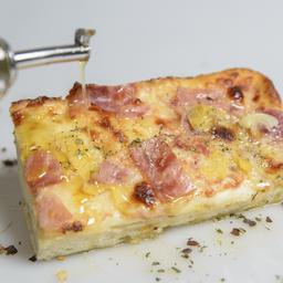 Pizza por porción Jamón y queso mozzarella
